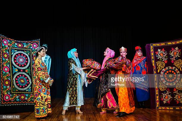 Actors in traditional Uzbek costume of 19 century perform wedding ceremony during quotInstants of Eternityquot show in theater of historical costume...