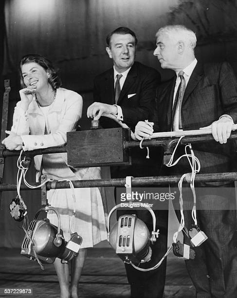 Actors Ingrid Bergman Michael Redgrave and Emlyn Williams discussing their play 'A Month in the Country' opening soon at the Cambridge Theatre London...