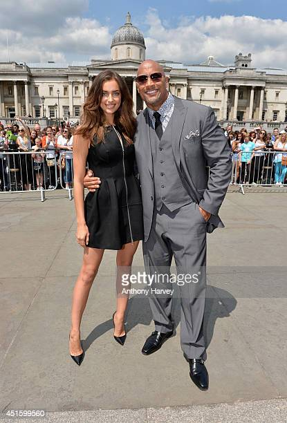 Actors Irina Shayk and Dwayne Johnson attend the photocall for Hercules at Trafalgar Square on July 2 2014 in London England