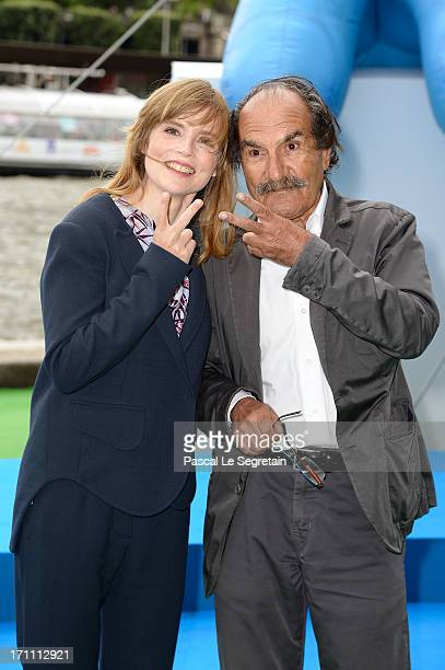 Actors Isabelle Carre and Gerard Hernandez pose as part of Global Smurfs Day celebrations on the Seine river bank on June 22 2013 in Paris France The...
