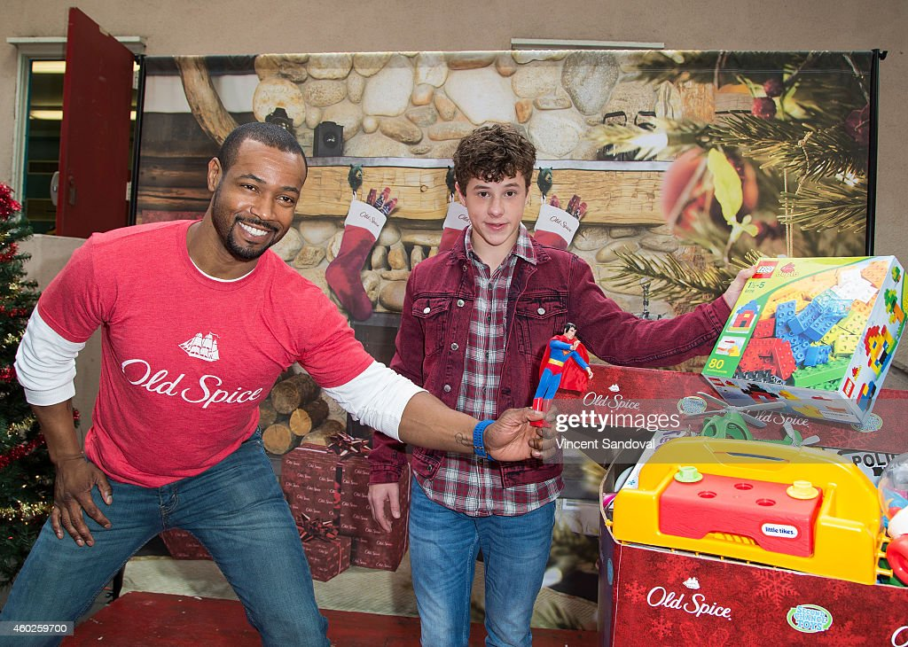 Actors Isaiah Mustafa and Nolan Gould attend the Inaugural Old Spice Holispray Holiday Toy Donation and Exchange Benefit for Second Chance Toys at Hollywood High School on December 10, 2014 in Los Angeles, California.