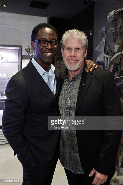 Actors Isaiah Washington and Ron Perlman attend the Opal Stone Luxury Handbags And Fine Jewelry Launch at Gray Gallery on December 8 2011 in Beverly...