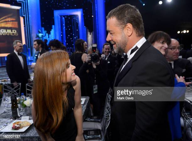 Actors Isla Fisher and Russell Crowe attend the 19th Annual Screen Actors Guild Awards held at The Shrine Auditorium on January 27 2013 in Los...