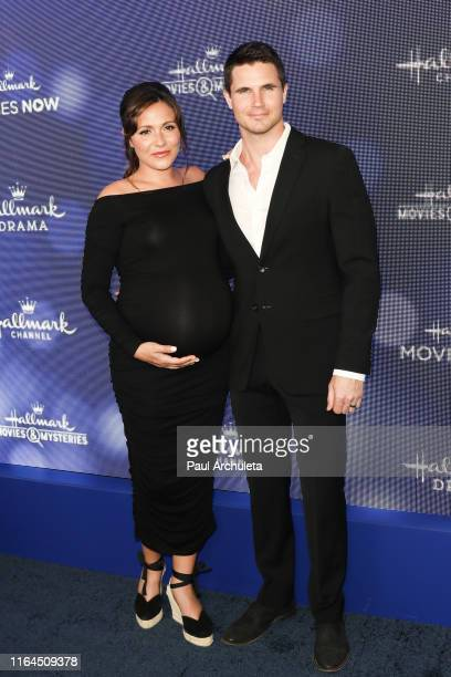Actors Italia Ricci and Robbie Amell attend the Hallmark Channel and Hallmark Movies Mysteries summer 2019 TCA press tour event at a Private...