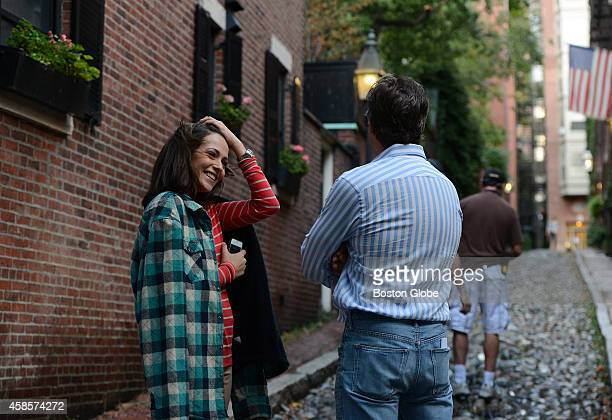 Actors Italia Riccia and Steven Weber take a break from rehearsing lines on October 11 2013 while filming Chasing Life on Acorn Street in Beacon Hill