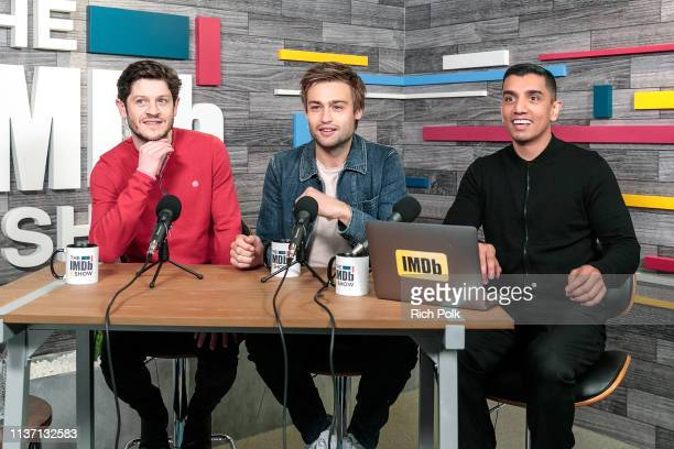 Actors Iwan Rheon and Douglas Booth with IMDb host Tim Kash on the set of 'The IMDb Show' on March 20 2019 in Studio City California