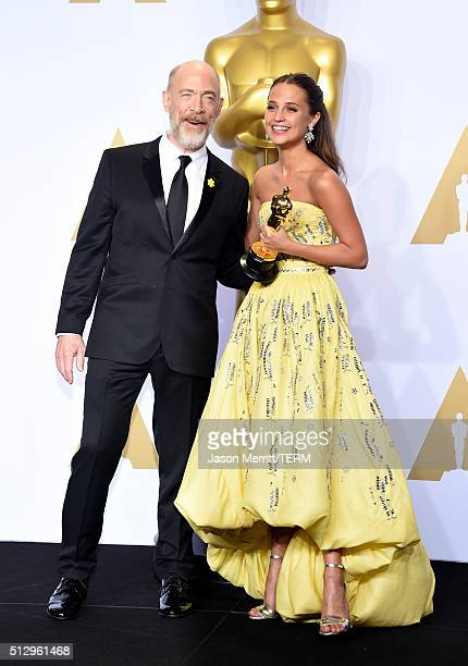 Actors J K Simmons and Alicia Vikander winner of Best Supporting Actress award for 'The Danish Girl' pose in the press room during the 88th Annual...