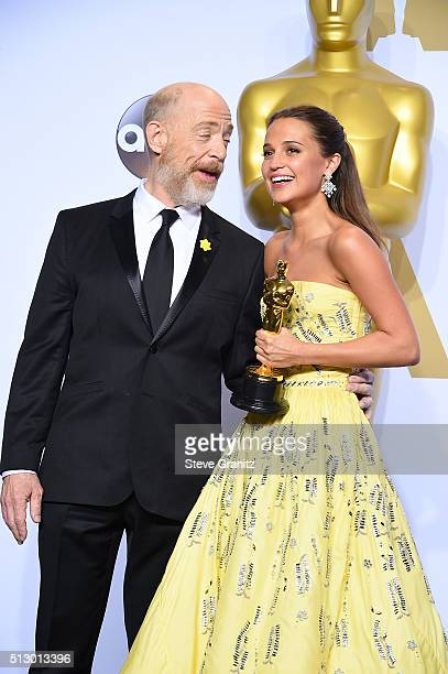 Actors J K Simmons and Alicia Vikander winner of the Best Supporting Actress award for 'The Danish Girl' pose in the press room during the 88th...