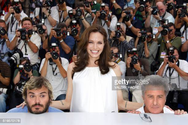 US actors Jack Black and Dustin Hoffman joke as they pose with fellow actress Angelina Jolie during a photocall for US directors John Stevenson and...