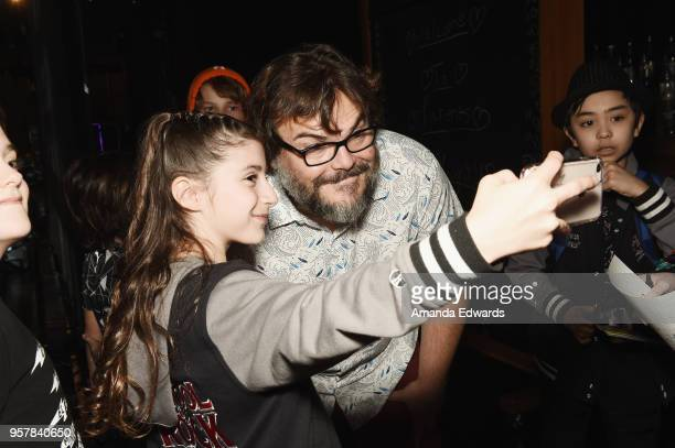 Actors Jack Black takes selfies backstage with castmembers after attending a performance of School Of Rock at the Pantages Theatre on May 12 2018 in...