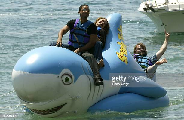 Actors Jack Black Will Smith and Angelina Jolie participate in a stunt during a photocall for the film 'Shark Tale' during the 57th International...