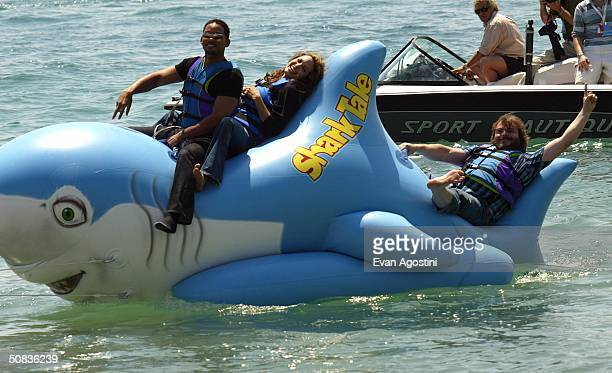Actors Jack Black Will Smith and Angelina Jolie participate in a stunt for the film 'Shark Tale' at a photocall for the film 'Shark Tale' during the...