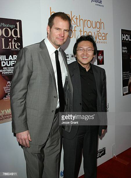 Actors Jack Coleman and Masi Oka arrive to the 7th annual Hollywood Life Breakthrough of the Year Awards at the Music Box at the Fonda on December 9,...