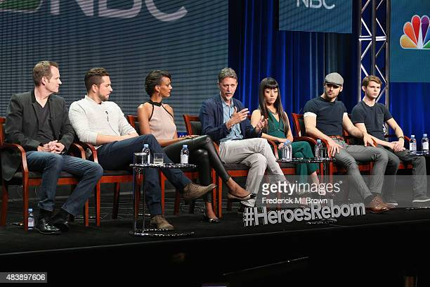 Actors Jack Coleman Zachary Levi Judi Shekoni executive producer Tim Kring actors Kiki Sukezane Ryan Guzman and Robbie Kay speak onstage during NBC's...