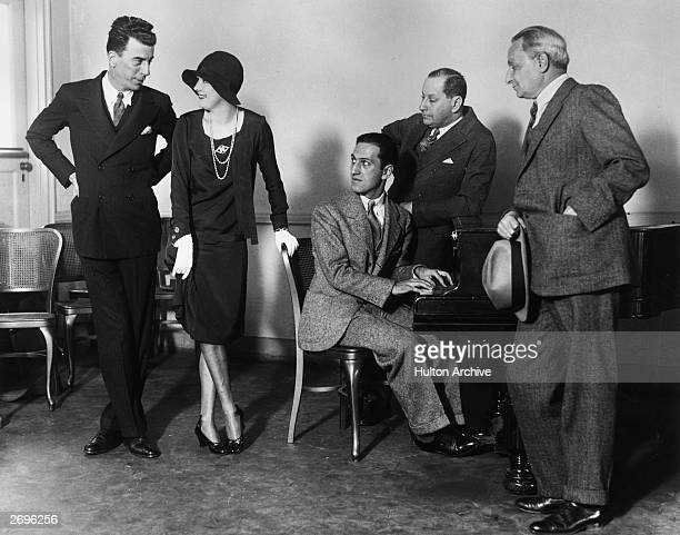 Actors Jack Donahue and Marilyn Miller composers George Gershwin and Sigmund Romberg and producer Florenz Ziegfeld Jr gather for a rehearsal of the...