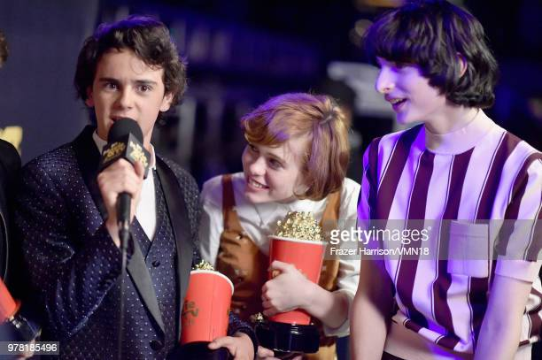 Actors Jack Dylan Grazer Sophia Lillis and Finn Wolfhard winners of Best OnScreen Team award for 'It' attend the 2018 MTV Movie And TV Awards at...