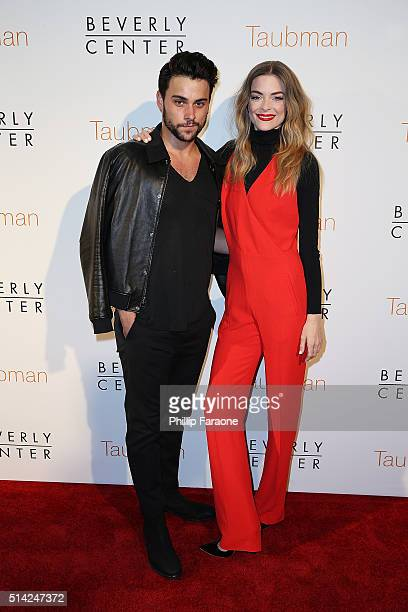 Actors Jack Falahee and Jaime King attend An Icon Reimagined open ceremony at The Beverly Center on March 7 2016 in Los Angeles California