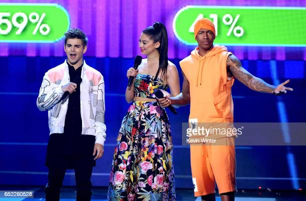 Actors Jack Griffo, Kira Kosarin and Nick Cannon speak onstage at Nickelodeon's 2017 Kids' Choice Awards at USC Galen Center on March 11, 2017 in Los...