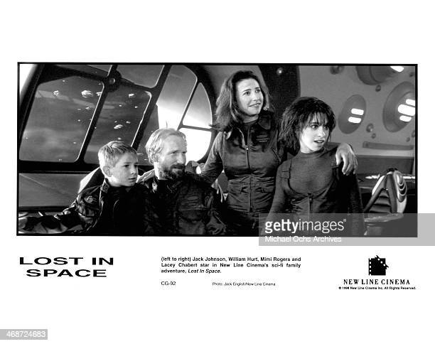Actors Jack Johnson and William Hurt and actresses Mimi Rogers and Lacey Chabert on set of the New Line Cinema movie ' Lost in Space ' circa 1998