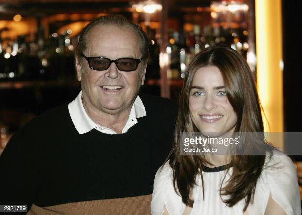 Actors Jack Nicholson and Amanda Peet pose at the press junket for their new film Something's Gotta Give at Claridges on February 2 2004 in London