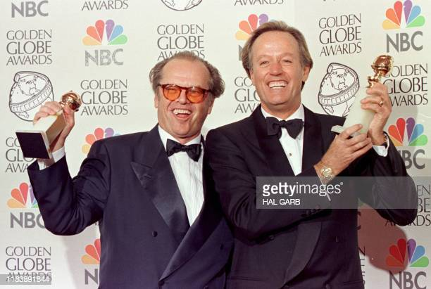 Actors Jack Nicholson and Peter Fonda hold their Golden Globe awards for Best Actor at the 55th Annual Golden Globe Awards 18 January in Beverly...