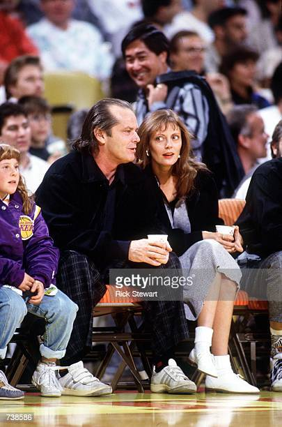 Actors Jack Nicholson, left, and Susan Sarandon attend a Los Angeles Lakers basketball game in the late 1980's at the Great Western Forum in...