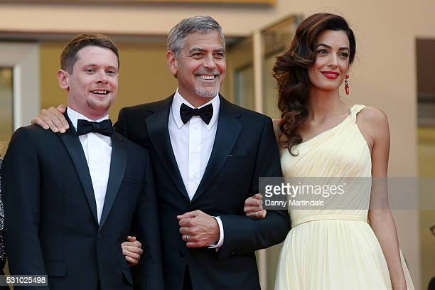 Actors Jack O'Connell George Clooney and his wife Amal Clooney attend the 'Money Monster' premiere during the 69th annual Cannes Film Festival at the...