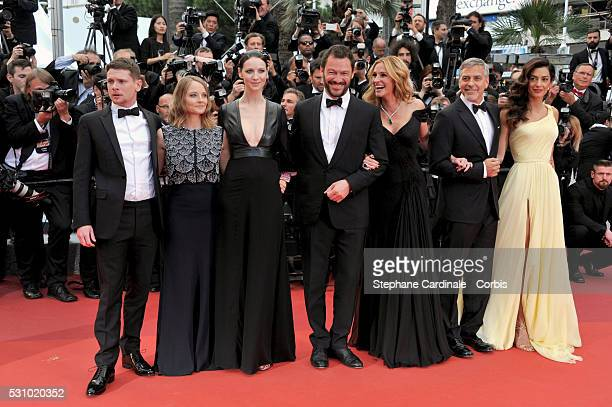 Actors Jack O'Connell producer Jodie Foster actors Caitriona Balfe Dominic West Julia Roberts George Clooney and his wife Amal Clooney attend the...