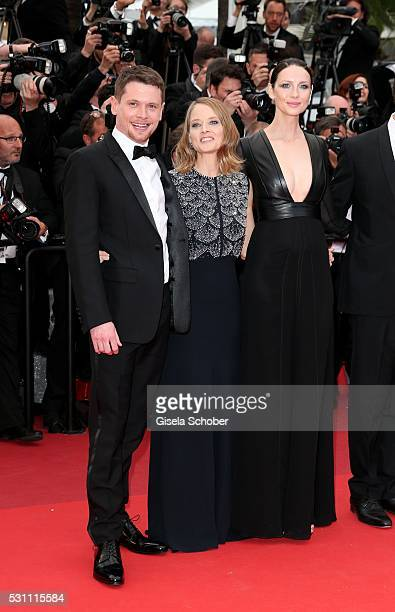 Actors Jack O'Connell producer Jodie Foster actress Caitriona Balfe attend the Money Monster premiere during the 69th annual Cannes Film Festival at...