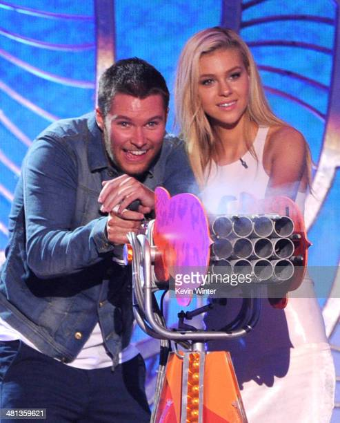 Actors Jack Reynor and Nicola Peltz speak onstage during Nickelodeon's 27th Annual Kids' Choice Awards held at USC Galen Center on March 29 2014 in...