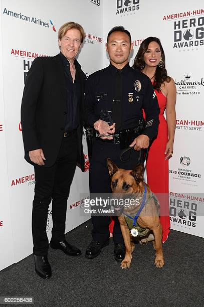 Actors Jack Wagner K9 Edo Law Enforcement Dog Category Winner and actress Alex Meneses are seen backstage during the Sixth Annual American Humane...