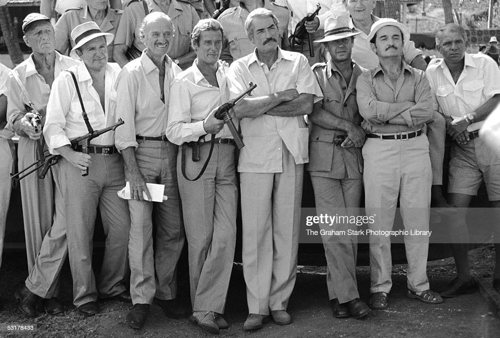 Actors Jack Watson, David Niven, Roger Moore, Gregory Peck and Graham Stark as ageing veterans recalled to duty in 'The Sea Wolves: The Last Charge of the Calcutta Light Horse', 1980.