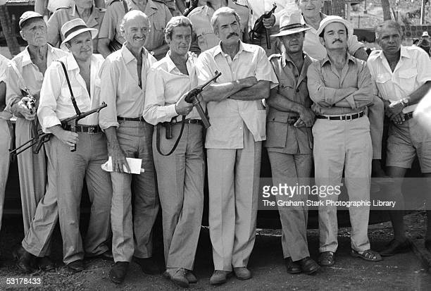 Actors Jack Watson David Niven Roger Moore Gregory Peck and Graham Stark as ageing veterans recalled to duty in 'The Sea Wolves The Last Charge of...