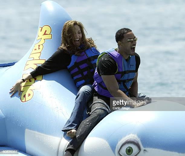 Actors Jack Will Smith and Angelina Jolie participate in a stunt at a photocall for the film 'Shark Tale' during the 57th International Cannes Film...