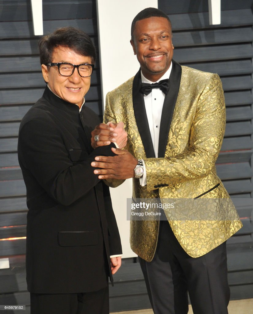 Actors Jackie Chan and Chris Tucker arrive at the 2017 Vanity Fair Oscar Party Hosted By Graydon Carter at Wallis Annenberg Center for the Performing Arts on February 26, 2017 in Beverly Hills, California.