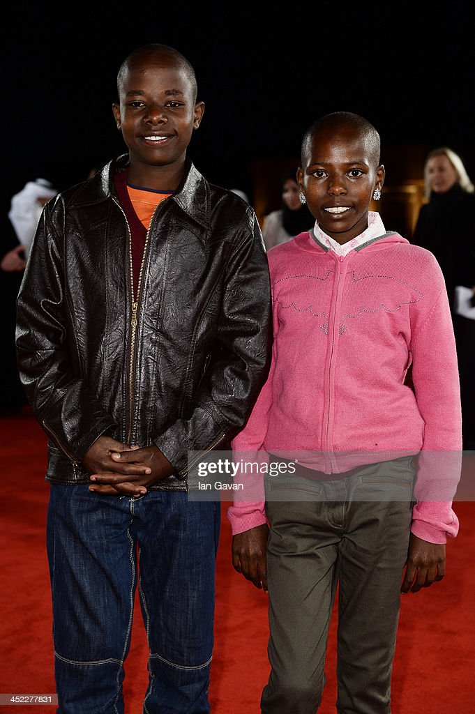 Actors Jackson Moloiyan Saikong and Salome Nasieku Saikong attend the 'On the Way to School' Premiere during day 2 of Ajyal Youth Film Festival on November 27, 2013 in Doha, Qatar.