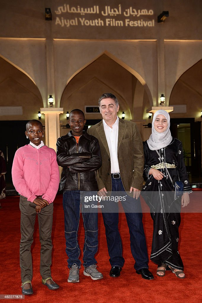 Actors Jackson Moloiyan Saikong, Salome Nasieku Saikong, director Pascal Plisson and actress Zahira Badi attend the 'On the Way to School' Premiere during day 2 of Ajyal Youth Film Festival on November 27, 2013 in Doha, Qatar.