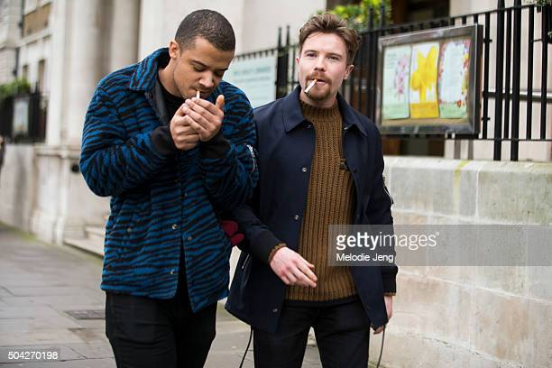 Actors Jacob Anderson and Joe Dempsie exit the Coach show during The London Collections Men AW16 at Vincent Square on January 9 2016 in London...