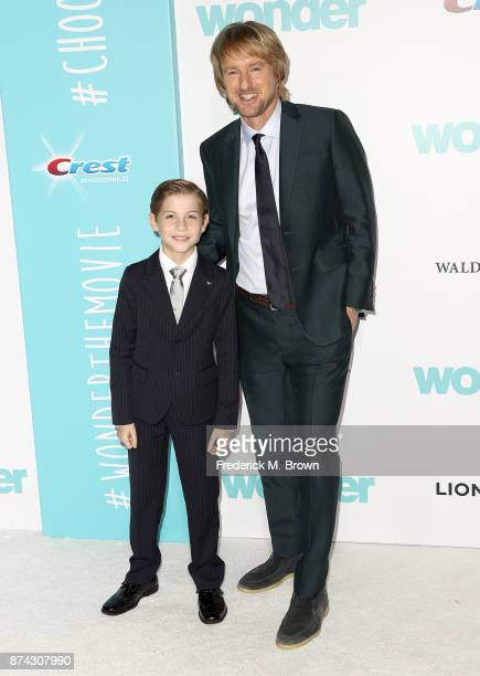 Actors Jacob Tremblay and Owen Wilson attend the Premiere of Liongate's 'Wonder' at the Regency Village Theatre on November 14 2017 in Westwood...