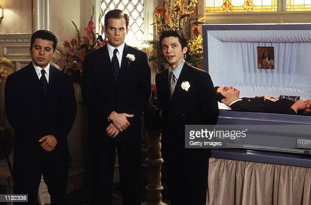 Actors Jacob Vargas Michael C Hall and Freddy Rodriguez are shown in a scene from the HBO series Six Feet Under The series about a family who owns a...