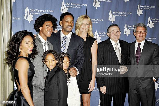 Actors Jada Pinkett Smith Trey Smith Jaden Smith Will Smith Willow Smith Charlize Theron Rabbi Marvin Hier and Universal's Ron Meyer pose at the...