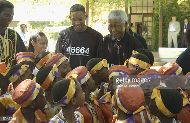 Actors Jada PinkettSmith Will Smith and Nelson Mandela join to meet HIV and AID's sufferers and one of this evening's acts the choir ahead of...