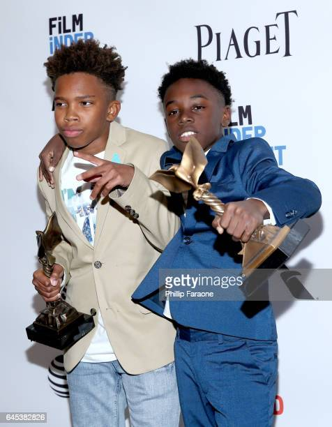 Actors Jaden Piner and Alex R Hibbert winners of the Robert Altman Award for 'Moonlight' pose in the press room during the 2017 Film Independent...