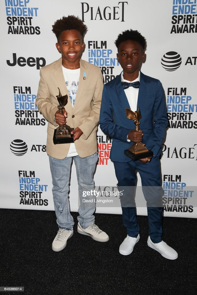 Actors Jaden Piner (L) and Alex R. Hibbert, winners of the Robert Altman Award for 'Moonlight,' pose in the press room during the 2017 Film Independent Spirit Awards on February 25, 2017 in Santa Monica, California.