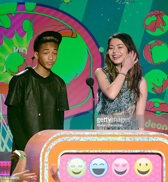 Actors Jaden Smith and speak Miranda Cosgrove onstage during Nickelodeon's 26th Annual Kids' Choice Awards at USC Galen Center on March 23 2013 in...
