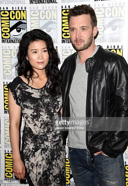 Actors Jadyn Wong and Eddie Kaye Thomas attend the CBS Television Studios press room during ComicCon International 2015 at the Hilton Bayfront on...