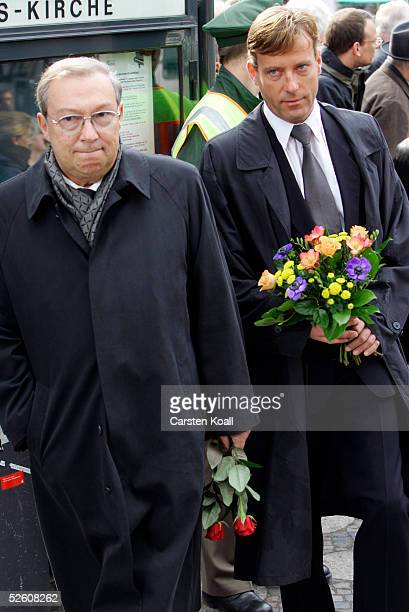 Actors Jaecki Schwarz and Hagen Henning arrive at the funeral services of late German actor Harald Juhnke at the Gedaechtniskirche church April 9,...