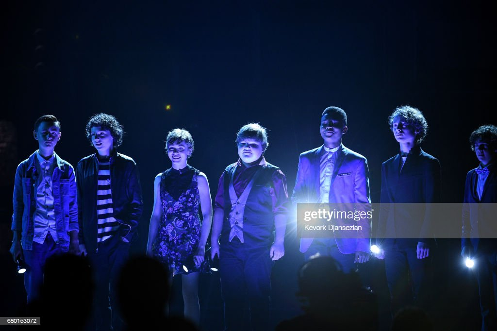 Actors Jaeden Lieberher, Finn Wolfhard, Sophia Lillis, Jeremy Ray Taylor, Chosen Jacobs, Wyatt Oleff, and Jack Dylan Grazer speak onstage during the 2017 MTV Movie And TV Awards at The Shrine Auditorium on May 7, 2017 in Los Angeles, California.