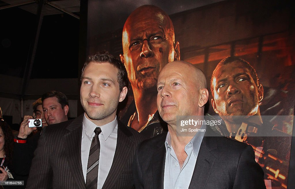 Actors Jai Courtney and Bruce Willis attend the 'A Good Day To Die Hard' Fan Celebration at AMC Empire on February 13, 2013 in New York City.