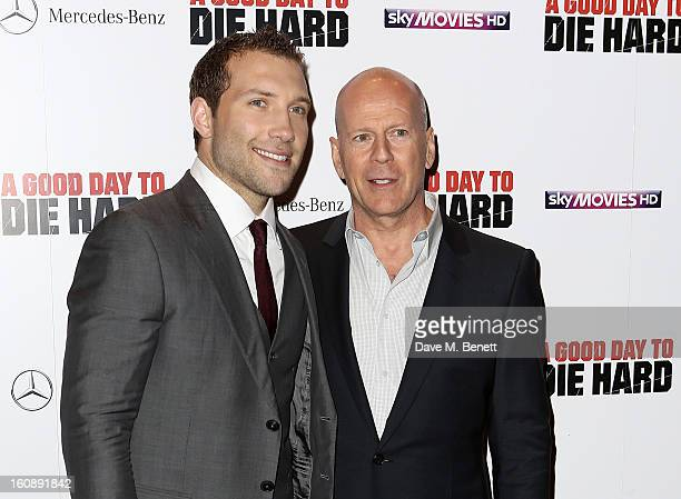 Actors Jai Courtney and Bruce Willis attend the UK Premiere of 'A Good Day To Die Hard' at Empire Leicester Square on February 7 2013 in London...